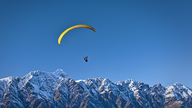 Paraglider over the Remarkables in Queenstown, New Zealand